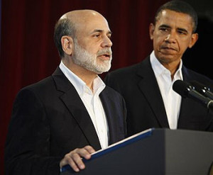 President Barack Obama looks on after announcing he is keeping Federal Reserve Board Chairman Ben Bernanke, left, for a second term, Tuesday, Aug. 25, 2009, during a news conference in Oak Bluffs, Mass. (AP Photo/Stephan Savoia)